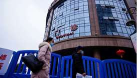 People walk past the Wuhan Central Hospital in Wuhan, in Hubei province, China