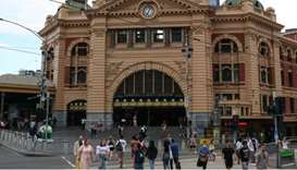 People enter and exit Flinders Street Station after a quarantine hotel worker tested positive for th