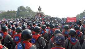 Phalanx of riot police face off protestors during a demonstration against the military coup at the m