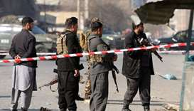 Afghan police officers stand guard at the site of an explosion in Kabul
