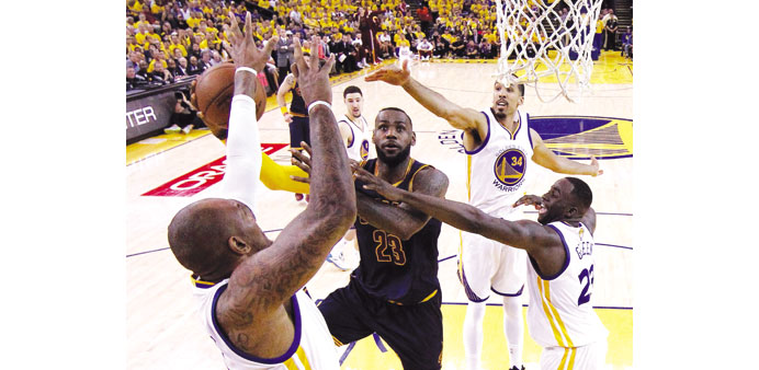 LeBron powers Cavs over Warriors to level Finals