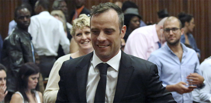 Oscar Pistorius reacts after he was granted bail as he leaves the North Gauteng High Court in Pretor