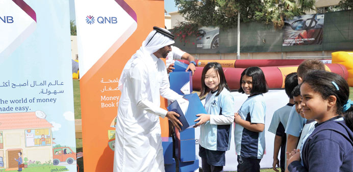 QNB team encourages pupils to save, invest