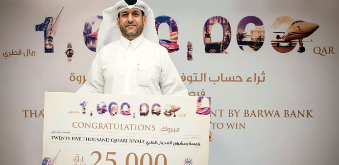 One of the winners of Barwa Bank's Thara'a draw.
