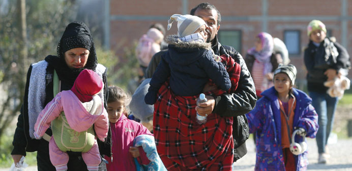 A family with children walks in the town of Kljuc Brdovecki to cross the Croatia-Slovenia border.