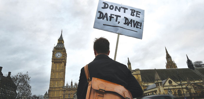 A lone protester outside the Houses of Parliament in London yesterday.