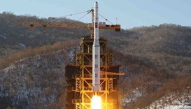 N Korea fires missiles, liquidates South assets