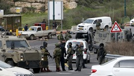 Israeli security forces gather near the scene of attacks