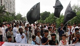 People protest against sectarian killings