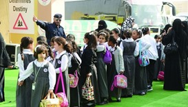 Schoolchildren visiting GCC Traffic Week events at Darb Al Saie.