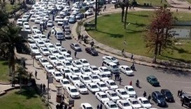 Taxis protesting against Uber and Careem services park on a busy road in central Cairo, causing traf