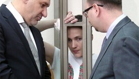 Ukrainian military pilot Nadiya Savchenko reacts inside a defendants' cage