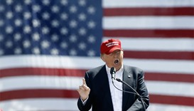 Republican presidential candidate Donald Trump speaks to guest gathered at Fountain Park during a ca
