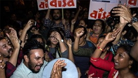 Indian students and activists shout slogans as they celebrate the release of the Indian student from