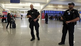 Atlanta police officers patrol at the check-in area