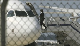 An official boards a hijacked Egyptair A320 Airbus at Larnaca Airport in Larnaca, Cyprus. Reuters