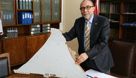 The head of Mozambique's Civil Aviation Institute, Comandante Joao Abreu, shows a piece of debris fo