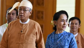 Myanmar's new president Htin Kyaw (L) and National League for Democracy party leader Aung San Suu Ky