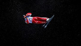 Men's Aerials training - Mischa Gasser of Switzerland performs an aerial