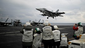 A U.S. F18 fighter jet lands on the deck of U.S. aircraft carrier USS Carl Vinson