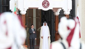 HH the Emir  and Turkmenistan President at the official reception ceremony at the Emiri Diwan
