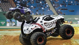 Monster trucks perform during the Monster Jam show
