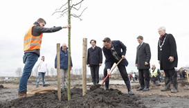 Families of victims plant first trees at MH17 memorial park