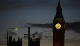 The sun sets behind the Houses of Parliament after an attack on Westminster Bridge in London, Britai