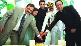 Ambassador Shahzad Ahmad and officers of the Pakistan embassy cutting the cake