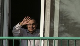 Mubarak waving to people from his room at the Maadi military hospital in Cairo