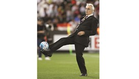 Qatar coach Jorge Fossati (top ) and his Iran counterpart  Carlos Queiroz react during the match on
