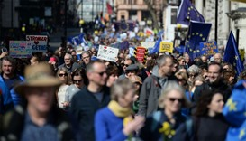 Demonstrators hold placards and wave EU flags during an anti Brexit, march in London