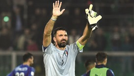 Buffon reaches 1,000 as Italy, Spain cruise