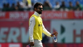 Virat Kohli walks back to the pavillion after a drink break during the first day of the fourth and l