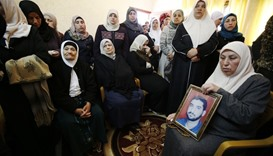 The mother (R) and relatives of Mazen Faqha, who was shot dead by unknown gunmen in the Gaza Strip