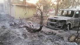A car burned down by the mob in Vadavali village, Gujarat