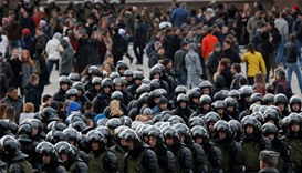 Law enforcement officers gather as they block opposition supporters in Moscow