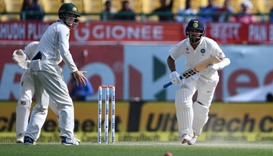 India's Murali Vijay (R) plays a shot during the fourth day of the fourth and final cricket Test mat