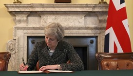 Britain's Prime Minister Theresa May, signs the official letter to European Council President Donald