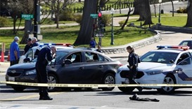 Woman held for driving into police car near US Capitol
