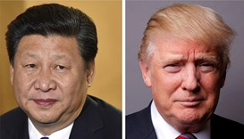 Chinese President Xi Jinping (L)  and US President Donald Trump