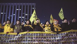 Relatives of victims of the 2014 Sewol ferry disaster join anti-government activists during a rally