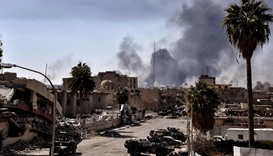 Smoke billows in west Mosul as Iraqi troops battle against Islamic State (IS) group fighters to furt