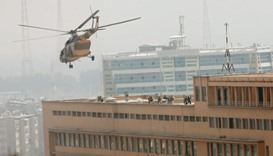 Afghan National Army (ANA) soldiers descend from helicopter on a roof of a military hospital