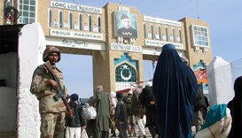 A Pakistani soldier keeps guard at the Friendship Gate, crossing point at the Pakistan-Afghanistan b