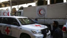 International Red Cross (CIRC) and Red Crescent aid trucks are seen in the besieged town of Douma, E