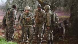 Turkish soldiers and Free Syrian Army fighters are seen after advancing in north of Afrin, Syria on
