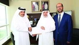 Doha Bank donates cash aid for QRCS relief campaign