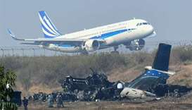 Nepal begins plane crash probe; airline defends pilot