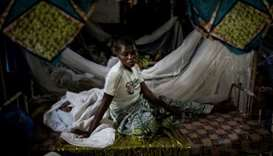 A Congolese woman rests with her newborn child at a clinic for displaced in Bunia.